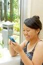 Free Asian Teen Girl Texting Royalty Free Stock Photo - 18118735