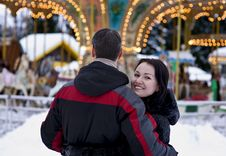 Happy Couple Looking At Carousel Royalty Free Stock Photography