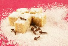 Free Blocks Of Sugar And Spiciness On A Red Background Stock Image - 18112771