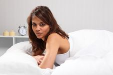 Beautiful Young Woman Waking Up In Bed Royalty Free Stock Image