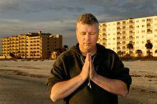 Free Man Praying In Front Of Hotels Royalty Free Stock Image - 18118856