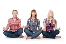 Free Three Girls Sitting In Lotus Posture Royalty Free Stock Photos - 18118888