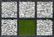 Rock And Artificial Grass Wall Stock Image