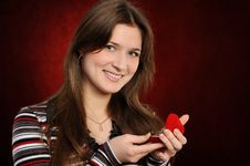 Free Young Woman With A Heart Gift Royalty Free Stock Image - 18119606