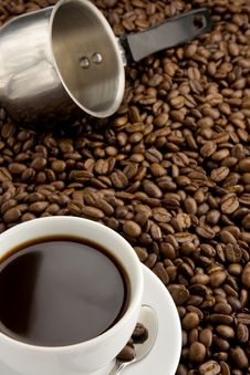 Cup Of Coffee And Pot On Beans Stock Photography