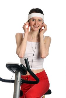 Happy Young Woman On A Training Bicycle Royalty Free Stock Image