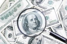 Magnifying Glass And Dollar Stock Photo