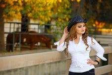 Free Cowgirl  Near A Fence Royalty Free Stock Photography - 18124517