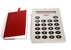 Free Great Calculator And Red Notebook For Reference Royalty Free Stock Images - 18126239