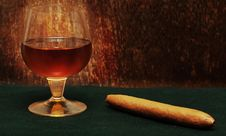 Free Cigar And A Glass Of Alcohol Royalty Free Stock Image - 18126346