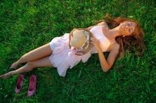 Free Sexy Young Girl Lying Down On Grass Stock Image - 18127601