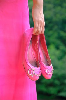 Free Hand Of A Young Girl Holding A Pair Of Shoes Royalty Free Stock Image - 18127666