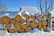 Fire Wood Under Snow Stock Photo