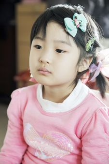 Chinese Little Girl Watching TV Royalty Free Stock Photos
