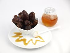 Free Dried Black Dates With Honey Stock Images - 18140564