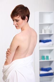 Beautiful Healthy Young Woman Shows Naked Back Royalty Free Stock Images