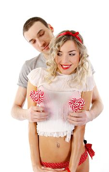 Young Couple With Candies Stock Photo