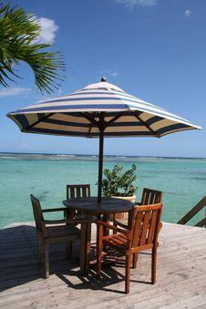 Free Caribbean Beach Table Under A Palm Tree Stock Photos - 18142343