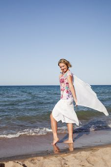 Free Girl Standing With Waving A Scarf Stock Images - 18143024