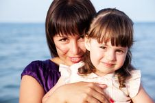 Mother Hugging Her Daughter Stock Images