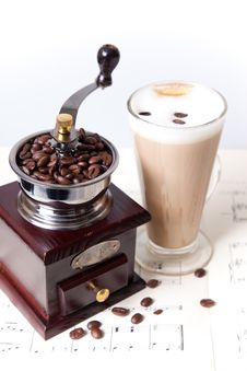 Coffee Grinder And Coffee On Sheet Music Royalty Free Stock Image