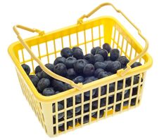 Yellow Shopping Basked Full Of Blueberries Stock Photography