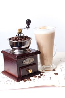Coffee Grinder And Coffee On Sheet Music Stock Images