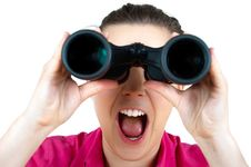 Surprised Girl With  Binoculars Royalty Free Stock Images