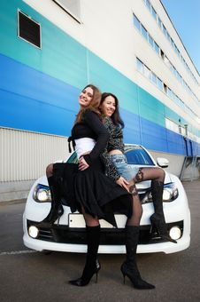 Two Beautiful Girls Friend And White Sports Car Royalty Free Stock Photography