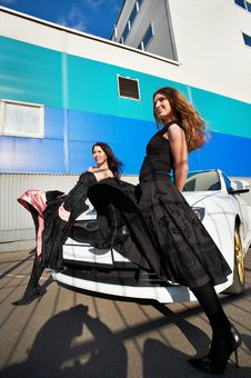 Two Beautiful Young Woman And White Sports Car Stock Photography