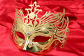 Free Gold Mask On Red Background Stock Photo - 18154590