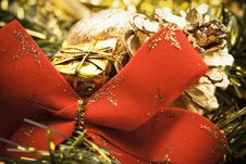 Christmas Red Bow And Golden Decoration Stock Image