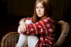 Woman Sits In A Chair Wearing A Sweater With The R Royalty Free Stock Images