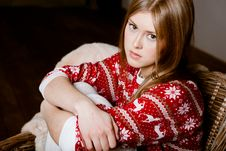 Woman Sits In A Chair Wearing A Sweater With The R Stock Photography
