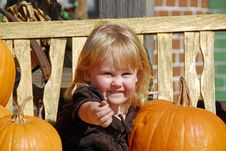 A Cute Little Girl At The Pumpkin Patch Stock Images