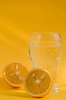 Free A Glass Of Soda And Two Chopped Oranges Stock Photos - 18156323