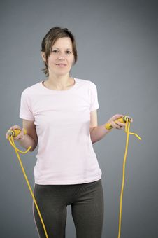 Woman Exercising Jumping Rope Stock Images