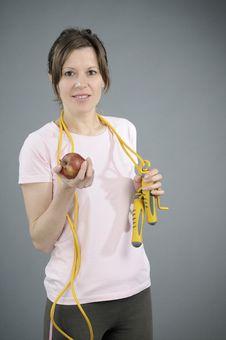 Free Aerobics Instructor Eating Apple Royalty Free Stock Photography - 18158107