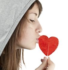 Free Candy Red Heart In The Girl S Lips Stock Photos - 18158133