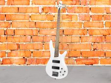 Free Brick Wall And And Guitar Stock Image - 18158511