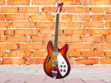 Free Brick Wall And Guitar Stock Photography - 18158532