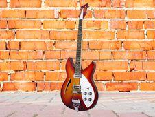 Brick Wall And Guitar Stock Photography