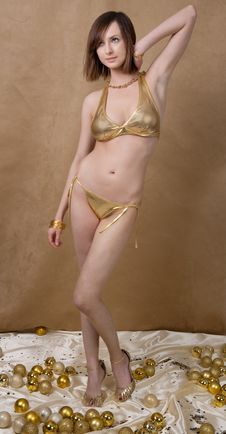 Free Thin, Lovely Model In Gold Bikini Stock Photo - 18158880