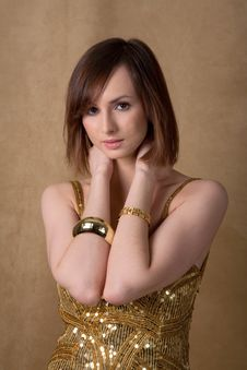 Free Beautiful Young Woman In Gold Dress Stock Photography - 18158942