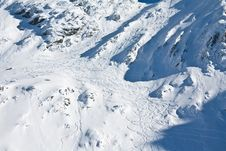Free Ski And Snowboard Tracks On Mountain Stock Images - 18162134