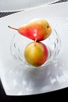 Free Two Appetizing Pears On Glass Plate Stock Photography - 18162912