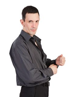 Free Young Man Buttoning-up A Sleeve Of His Black Shirt Royalty Free Stock Image - 18163616