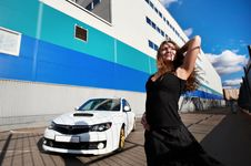 Beautiful Girl And Stylish White Sports Car Stock Photography