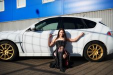 Free Young Woman Near White Sports Car Stock Photography - 18164532