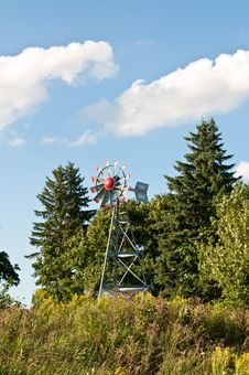 Windmill With Trees And Blue Sky Stock Images